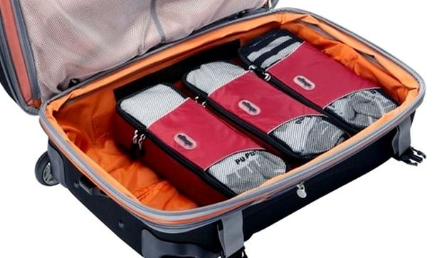 When considering luggage accessories, packing organizers should be at the top of your list! Minimize and organize with these features travel packing aids.