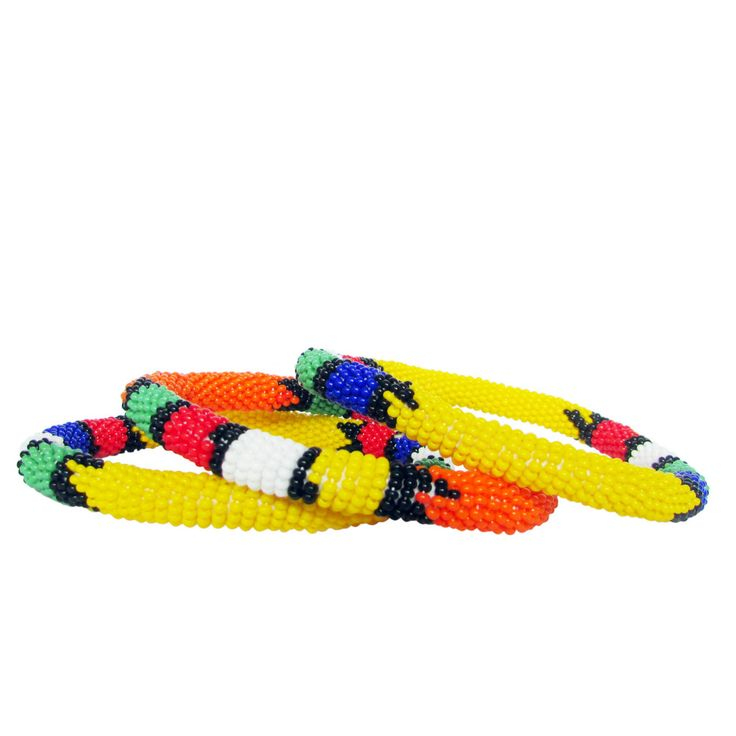 Zulu Seed Bead Bangles - Yellow  Zulu beading is popular the world over. These handmade, ethically made bangles are very popular. Each one is unique and different. Light weight, they add a pop of color and personality to your outfits. Fun!!