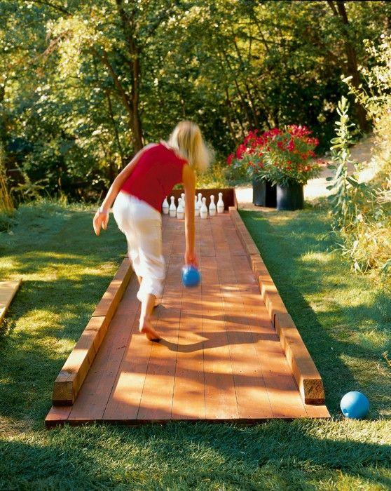 What a great idea!  A backyard bowling lane made from wood flooring / planks!