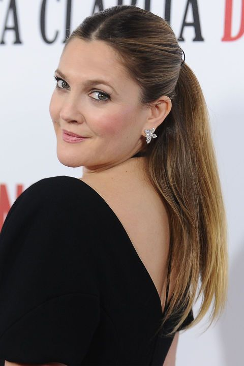 For a polished look, steal Drew Barrymore's updo idea with a sleek, side part in front and smooth voluminous strands in back.