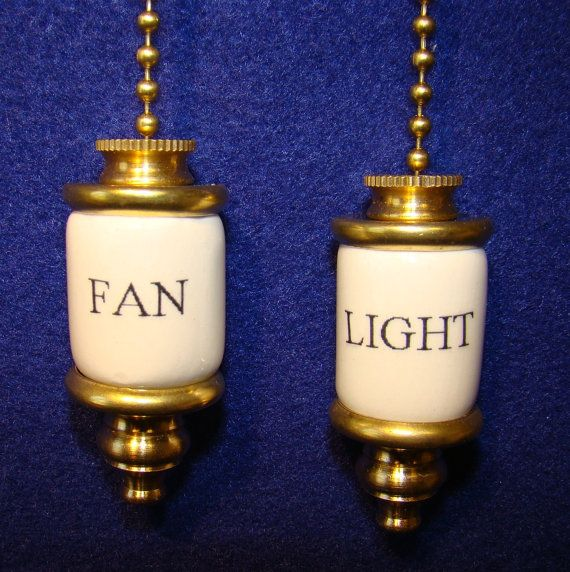 fan & light ceiling fan pull chain, set of 2, 2 long & 3/4 dia. with approx 16 brass chain. brass ends threaded on a metal rod thru a glazed
