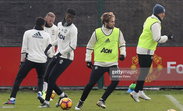 Axel Tuanzebe and Daley Blind of Manchester United in action during a first team training session at Aon Training Complex on February 8, 2017 in Manchester, England.