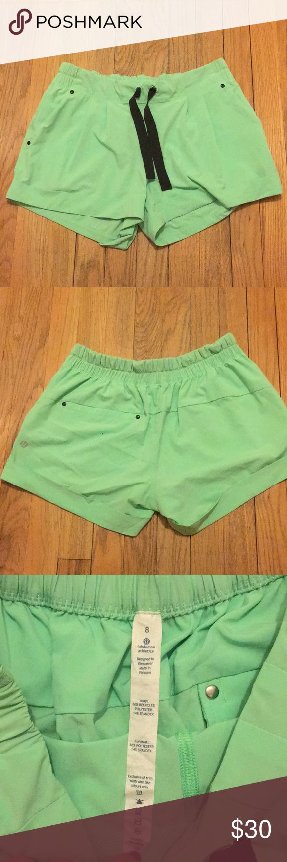 Neon Green Lululemon Shorts Very cute Lululemon Neon Green shorts with two front pockets and one back pocket with black tie. Super cute comfy shorts that have only been worn once. Size 8! lululemon athletica Shorts