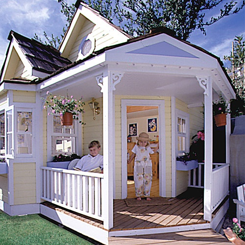 The Cottage Playhouse has a partial-wrap country porch, bay window with window box, shingled roof and an octagonal window in its large gable. It is shown here in yellow with white and periwinkle trim. This playhouse, designed and built by Alan Mowrer, can be constructed with countless interior and exterior options. Whether it's cable, running water, electricity, central air or a wireless communication system, Alan can accommodate your wishes.