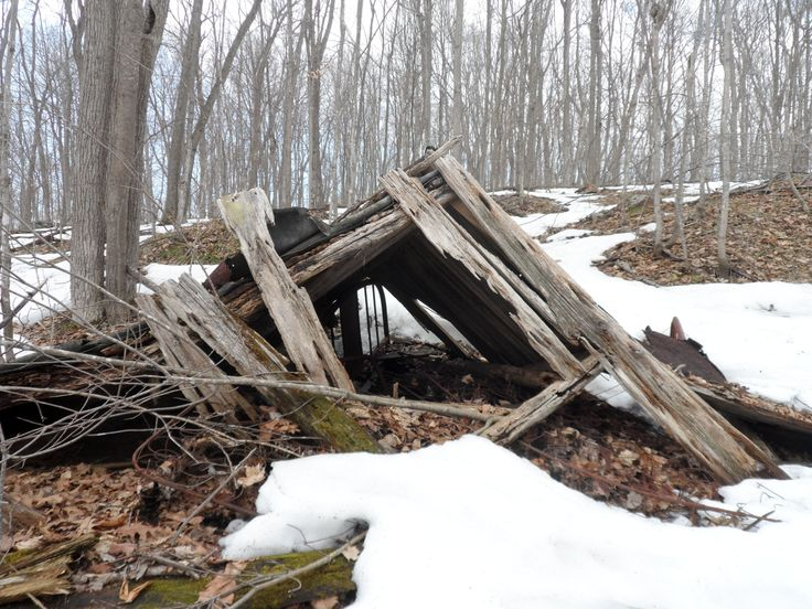 Think this is the Crab Lake Mine on the Tetsmine Lake Loop. Old house that has fallen down. Bed spring, headboard and footboard in the house at Frontenac Provincial Park @Ontario Parks