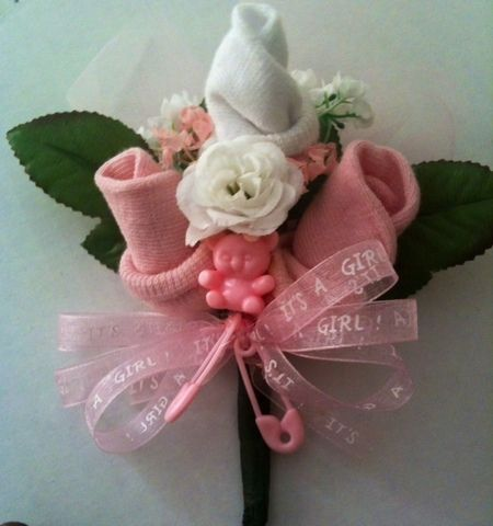 baby sock corsage, this is cute to put on mother for the baby shower