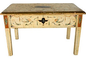 Extraordinary and elaborately fanciful hand-painted details define this unique painted Italian table, purchased at auction in Milan. Early 20th-century and exquisitely aged by time with some restoration. Grotesque motifs may have been inspired by Uffizi murals.