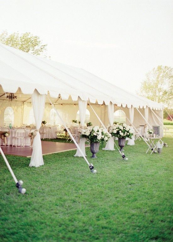 Fabric covering tent poles - ABSOLUTELY what i have pictured for reception....just more color for me :)