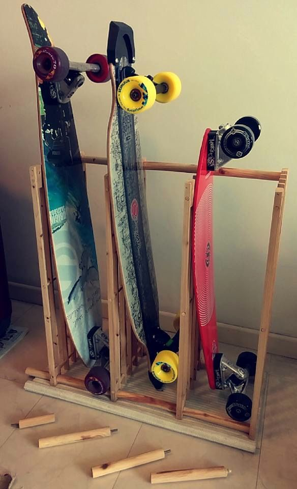 Check this out: The £6 Skateboard / Longboard Rack. https://re.dwnld.me/5H6XZ-the-6-skateboard-longboard-rack