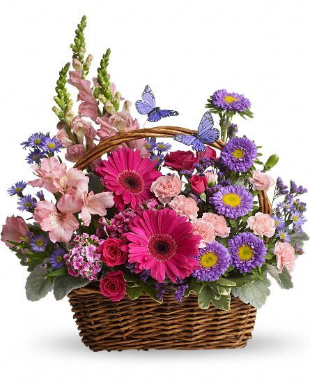 Here's another basket of flowers I really like. What's up with the butterflies? I like the look of them in the photo, but I just hope they're made of something that's Eco-friendly and cruelty-free!