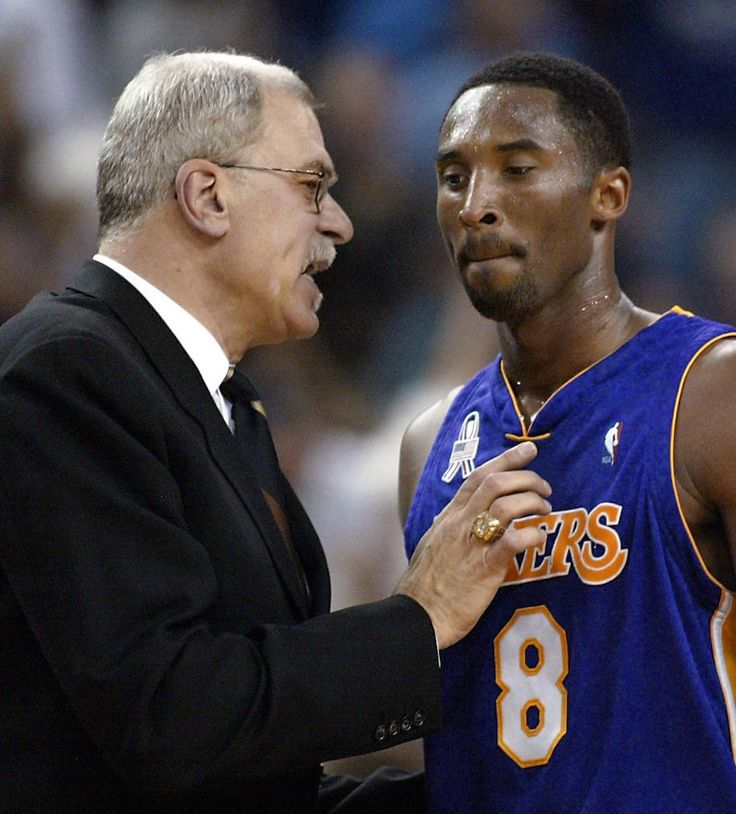 Kobe & Phil  Los Angeles Lakers head coach Phil Jackson (L) has a word with Lakers Kobe Bryant during the first half of game one of the NBA Western Conference Finals against the Sacramento Kings, 18 May 2002, at ARCO Arena in Sacramento, CA. (Photo: JOHN MABANGLO/AFP/Getty Images)