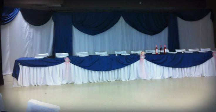 Blue Satin head table with broaches.
