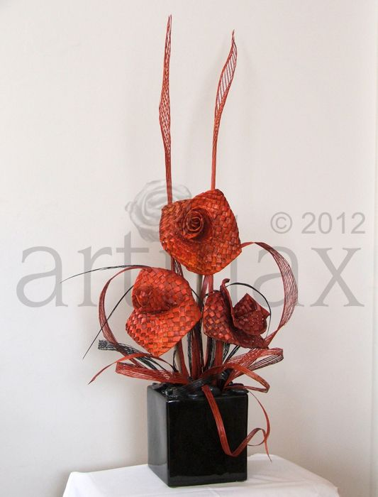 Gorgeous orange and black flax flower arrangement