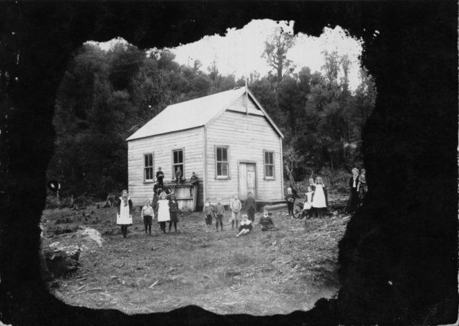 Creator unknown :Photograph of children outside a building, possibly a schoolhouse at Waihi, Hauraki district