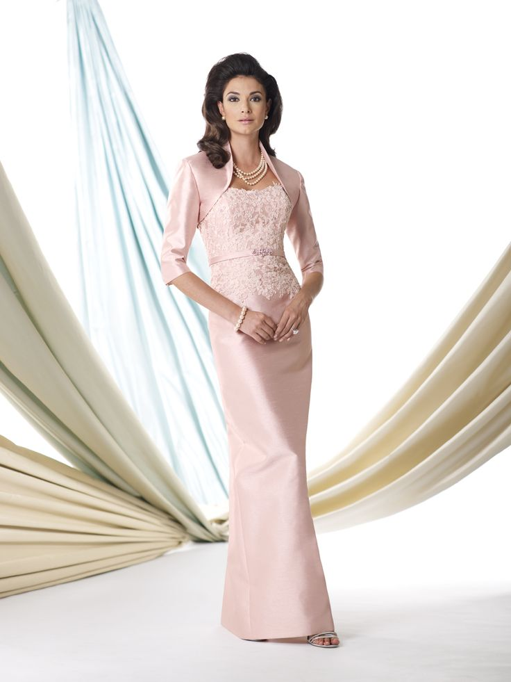 Two-piece shantung suit, strapless sheath with softly curved neckline, hand-beaded lace bodice with center beaded belt at natural waist, slim skirt with center back slit, matching bolero jacket with three-quarter length sleeves, suitable for the mother of the bride or the mother of the groom. Removable straps included. Sizes: 4 – 20 Colors: English Rose, …