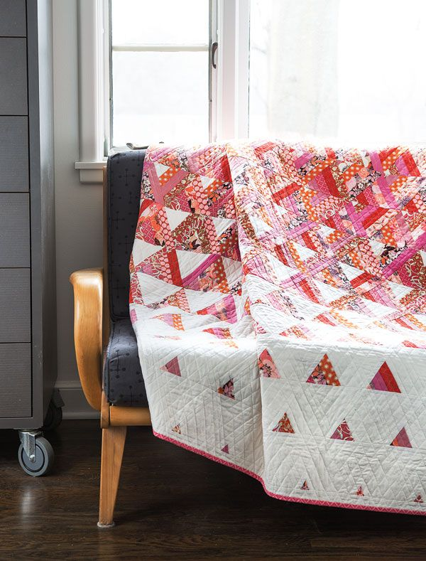 It's no surprise that Designer Tanya Finken named this quilt Trifecta — the entire quilt is made up of triangles. It may look complicated, but it's nothing more than cutting triangles from strip sets. Digital pattern available.