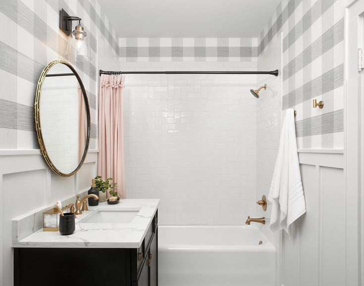 All the different textures used in the master bathroom were a fun way to add even more charm in here. The combination of the original tile, buffalo check wallpaper, brass hardware and the wainscoting all came together to create a really beautiful bathroom with a lot of interesting layers.