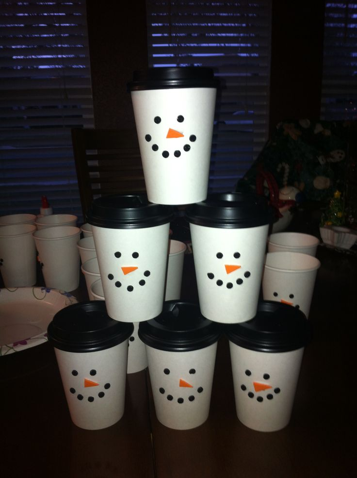 white disposable coffee cups. Inside each one is a bag of hot chocolate mix, mini marshmallows, chocolate chips, and a mini candy cane to stir it all together Maybe for party favors