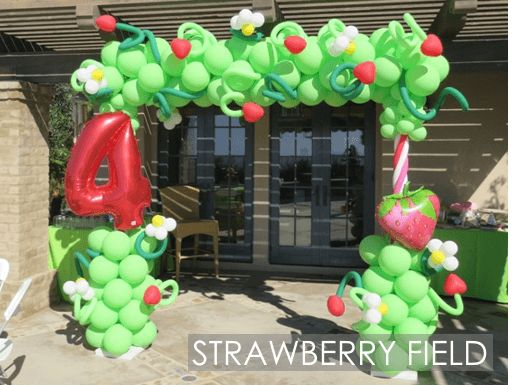 4th Birthday in a Strawberry Patch, highlighted by this Balloon Arch.