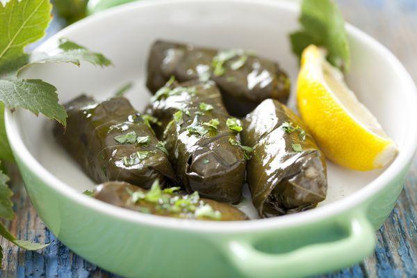 Dolmades (Ντολμάδες): Vine leaves stuffed with rice.