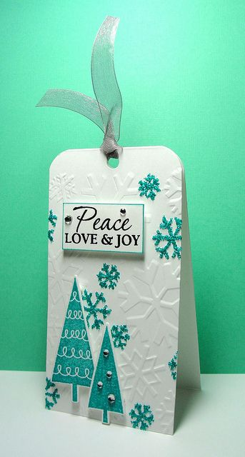pretty Christmas gift tags - top fold, snowflake embossed with random flakes glittered ... triangle trees glued on ... 3D label stamped Peace, Love & Joy ...