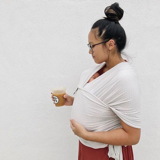 """The double whammy of a 6 week growth spurt + sleep regression is hitting us hard this week. Hoping this is the final hurdle before a full night's sleep! Until then, mom bun, baby-wearing and ☕️☕️☕️."" Who else is living this right now? // @aninawatt #onlycoldcoffeewhilebabywearing"