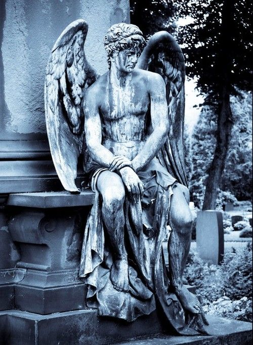 Graveyard stone statue of an angel, or an heroic nude male with wings, seated and pensive. www.vitruvianlens.com