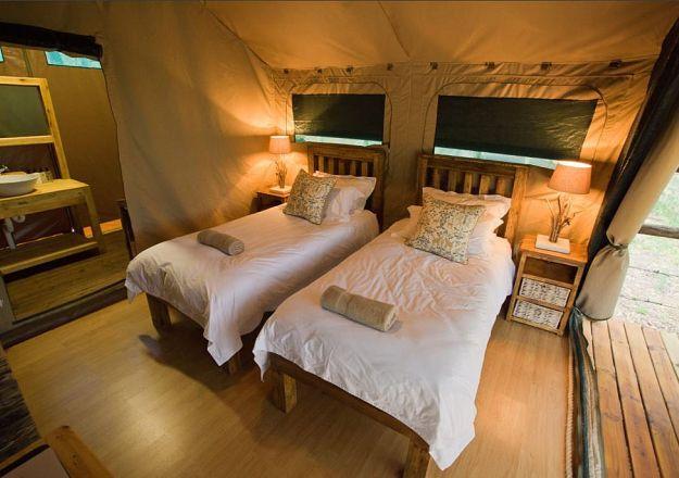 The interior of one of the gorgeous glamping tents at Rukiya Safari Camp.
