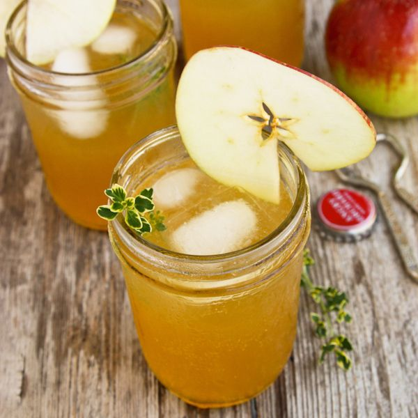 Whether you're sitting around the fire pit or entertaining for Thanksgiving, this Harvest Apple Sangria with Bourbon and Thyme is perfect for fall.