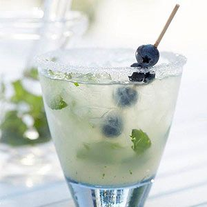 Blueberry Mojitini: (4 servings) In large pitcher stir 2 cups water, 1/3 c sugar, 1/4 c lime juice.  Combine & chill 1-12 hrs.  Add 1/2 c acai-blueberry or blueberry vodka.  Bruise mint leaves, place in bottom of sugar rimmed glasses.  Fill with ice, fill with mojitini, garnish with blueberries
