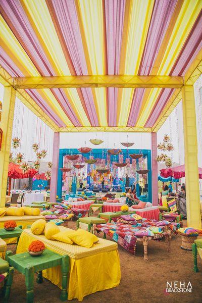 Mela theme mehendi, funky mehendi decor , umbrella decor for mehendi , charpoi decor , stools , flea market theme