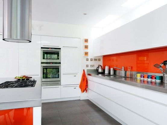 All White Kitchen With Orange Accents