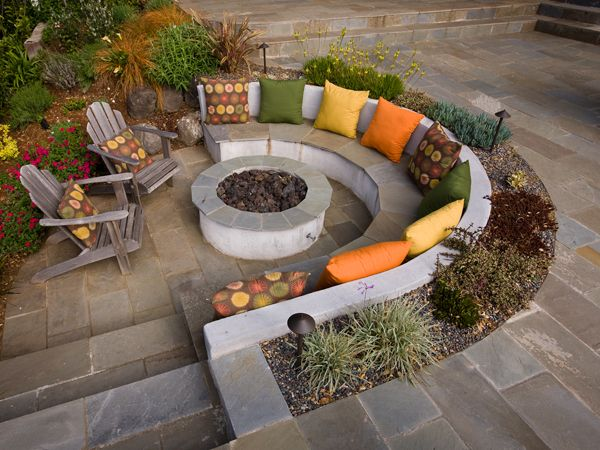 like the idea of sunken to protect from the wind and like how the shape of the bench matches the firepit for maximum warmth