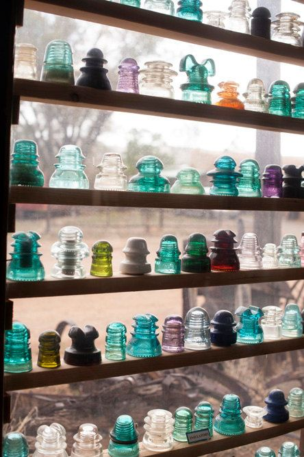 Vintage glass insulators  decorative by tracycarlsonphoto on Etsy, $30.00.  Do this in garden house for Grandma's Turquoise BALL Jars!
