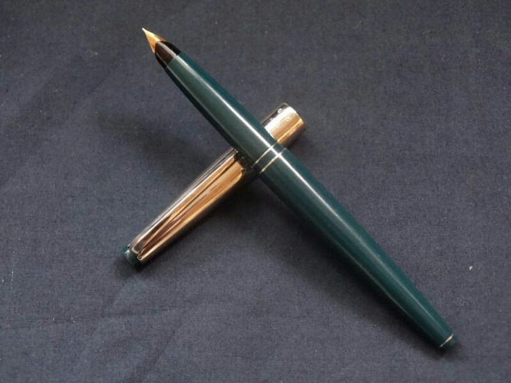 "My Wing Sung 200 that is a near-clone of the Parker 45. Unlike the Parker 45 ""convertible"", this pen has a true aerometric filling system, with a breather tube."