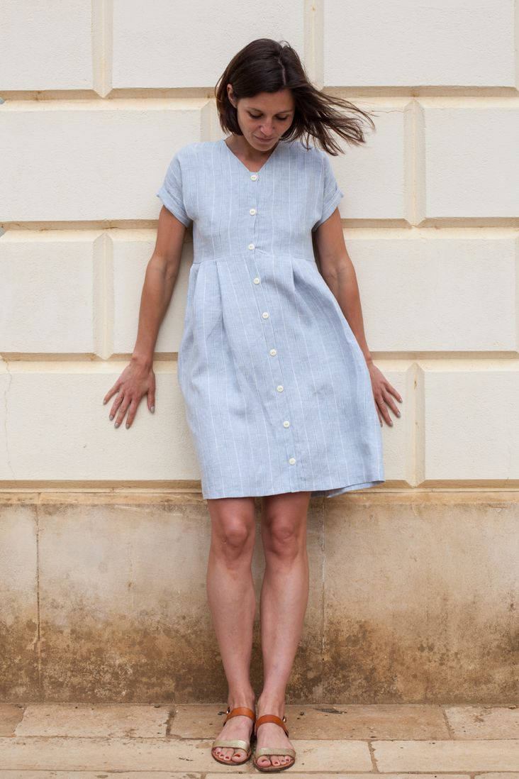 Looking for a project to enrich your sewing skills? This cute little dress has it all: interfaced neckline, button down front, sleeve cuffs, pleats and inseam pockets. In this tutorial we are going to show you how to sew all of it using linen fabric, which is a pure pleasure to wear and to work with. And if you are already a pro at all the listed techniques, this is a sweet little dress to make for yourself, as a gift to your friend, or to size down to make for a little girl. Enjoy…