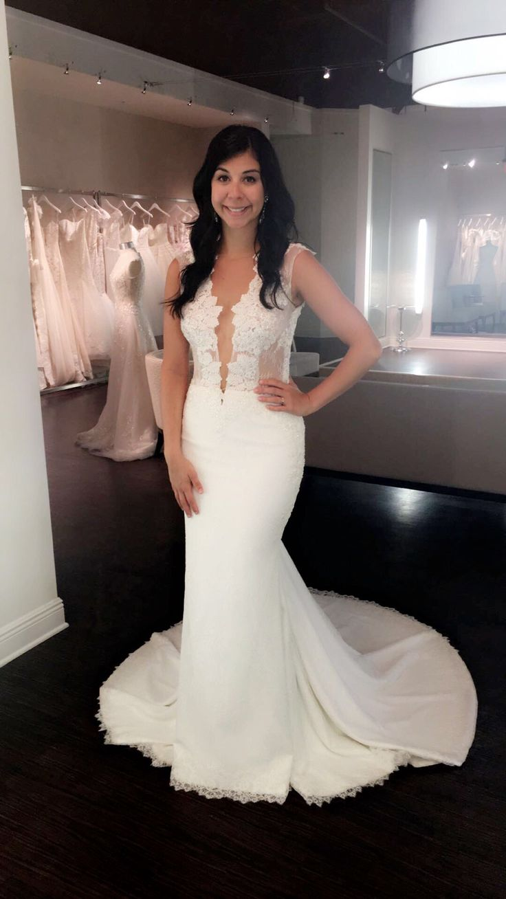 Plunging neckline, lace wedding dress from Solutions Bridal.    Ines Di Santo wedding dresses.
