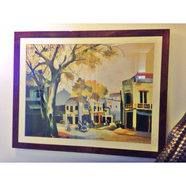 Hand embroidery of an autumn street scene with tree framed in beautiful walnut veneer frame