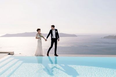 Elegant elopement at Anastasis Apartments. Photo from real destination wedding in Santorini by Phosart Photography & Cinematography. See more: http://photographergreece.com/en/photography/wedding-stories/919-elegant-elopement-at-anastasis-apartments