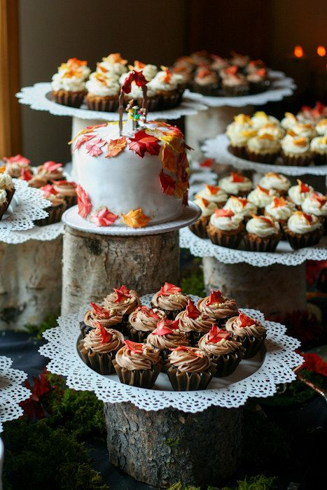 Make a multilevel dessert display using logs and Skurar candle dishes. | 25 Clever Ways To Use Ikea Products At Your Wedding