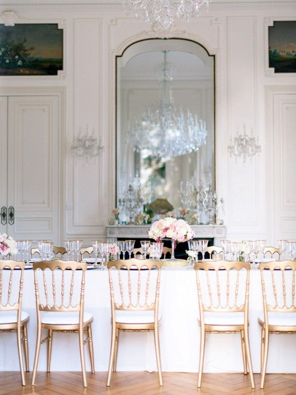 French Chateau wedding - vintage homes - huge mirror, oversized room, gold chairs, gold rimmed glassware