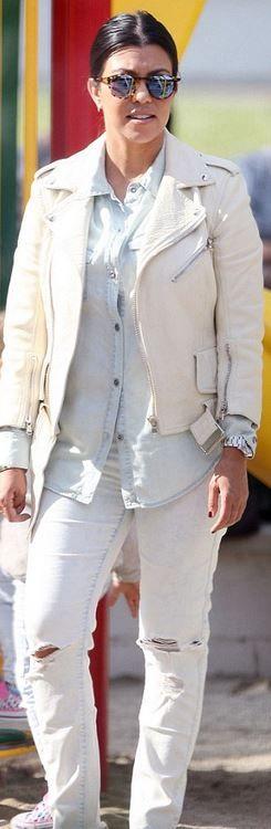 Kourtney Kardashian: Bracelet – Cartier  Jacket – Alexander McQueen  jeans – Black Orchid