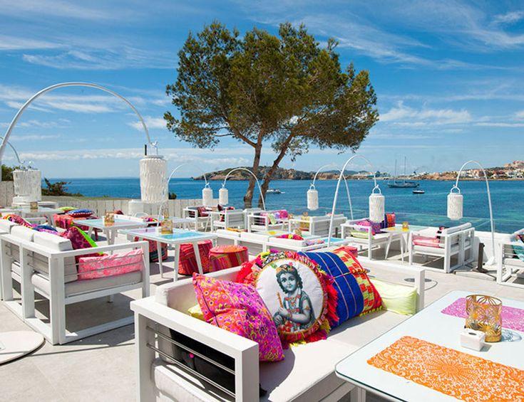 fabulous terrace! crisp, white base with gorgeous bright accents at Patchwork restaurant in Pouet Talamanca, Ibiza, Spain #elle.es