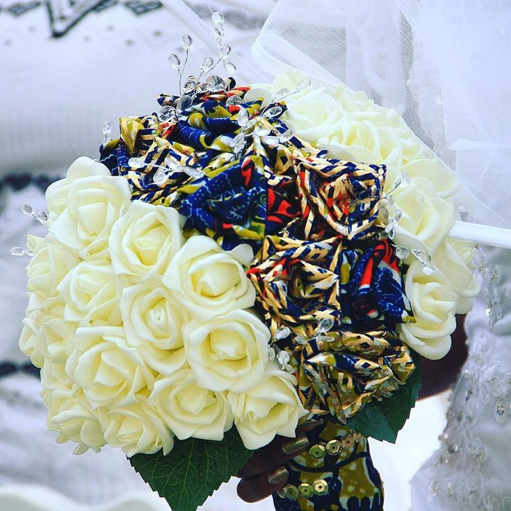 "My ever loving ankara brides bouquet! This was handmade for me by a lady in Ghana who is just starting her business in wedding decorations! This lady is very creative and understanding. I told her my ideas and within seconds she understood me. This is her first attempt of making the bouquet and she nailed it! The first time i saw it i was speechless ""wauw"" she brought my imagination into reality!  #terracles #ghanawedding #ghweddings #ghana #wedding #idoghana #accra #tema #love…"