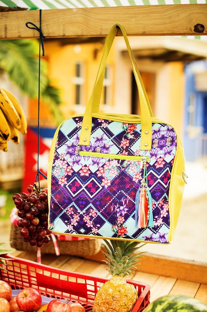 Bring out your personality with this trendy little beach bag. This designer bag features a gorgeous floral print and hand made tassel. Grab your fabulous beach tote and head for the beach. Don't worry we've already ordered your drink and it's being delivered to your favorite spot on the beach. We described your bag so it'll be easy to find you.  #bag #floralprint #boho