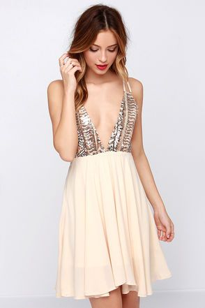 Treat yourself with something sweetly decadent like the Tasty Strappuchino Cream Sequin Dress! A plunging V-bodice makes the perfect topper to this cream woven poly dress (with peachy undertones), and front panels adorned in vibrant chevron patterns of copper, ivory, and gunmetal sequins. Double straps ascend from the bodice and cross onto the back, connecting at the elastic waist to form chic V's. Cream skirt hangs below. Fully lined. 100% Polyester. Hand Wash Cold. Imported.