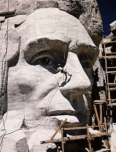 Citation: Carving of Abraham Lincoln at Mount Rushmore, ca. 1934 / unidentified photographer. Mount Rushmore monument photographs, Archives of American Art, Smithsonian Institution.