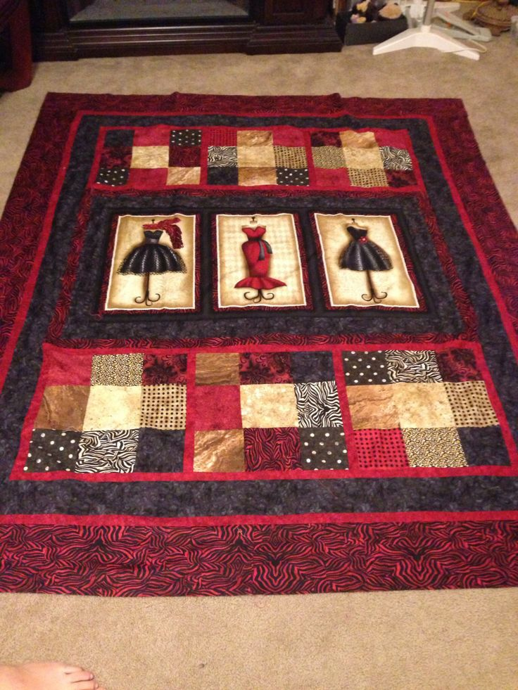 Quilt Made Using A Panel And A Nine Patch Design Red And