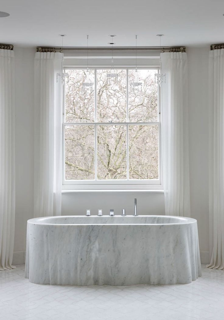 The Cascata bath tub in Carrara marble by Chesney's.