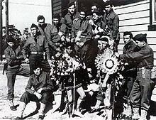 Two Comanche code-talkers were assigned to each regiment, the rest to 4th Infantry Division headquarters. Shortly after landing on Utah Beach on June 6, 1944, the Comanches began transmitting messages. Some were wounded but none killed.[6]    In 1989, the French government awarded the Comanche code-talkers the Chevalier of the National Order of Merit. On November 30, 1999, the United States Department of Defense presented Charles Chibitty with the Knowlton Award.